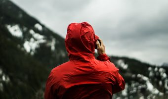 man wearing jacket in the mountains