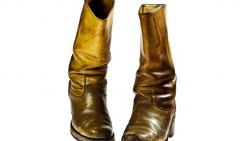 pair of yellow snake boots
