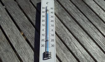 thermometer on gray wood flooring