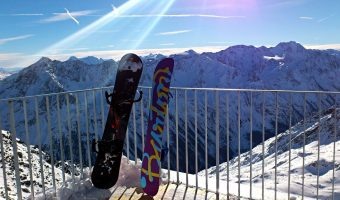 best snowboards reclined on a rail