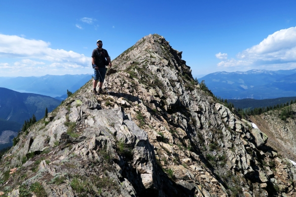 man on top of rocks after scramble