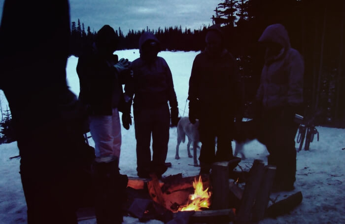 people gathered around a fire