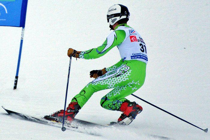 alpine skier skiing on snow