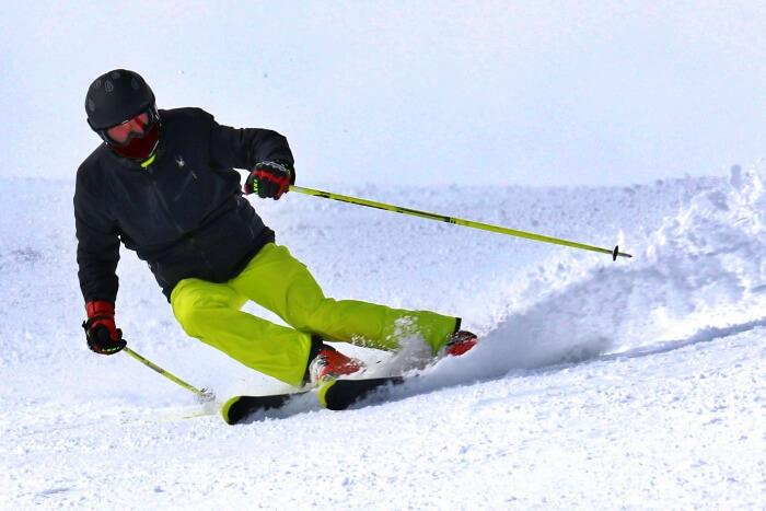 skier sliding down snowy slope