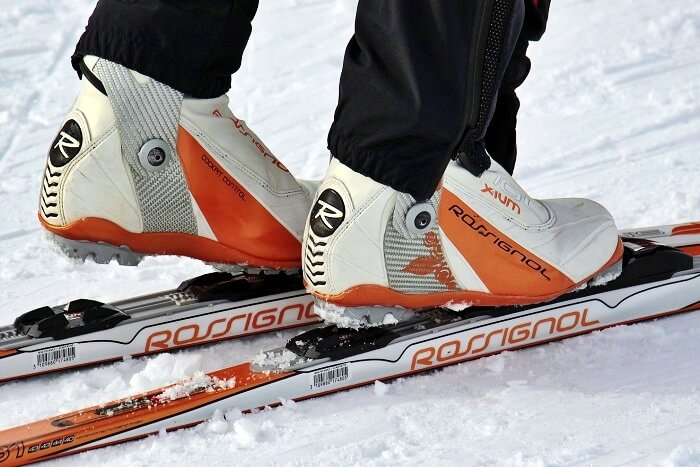 closeup on rossignol skiing boots and skis