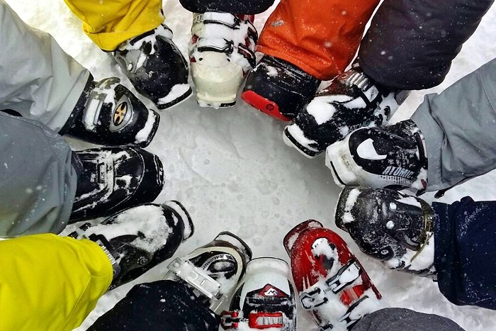 closeup on a circle of ski boots