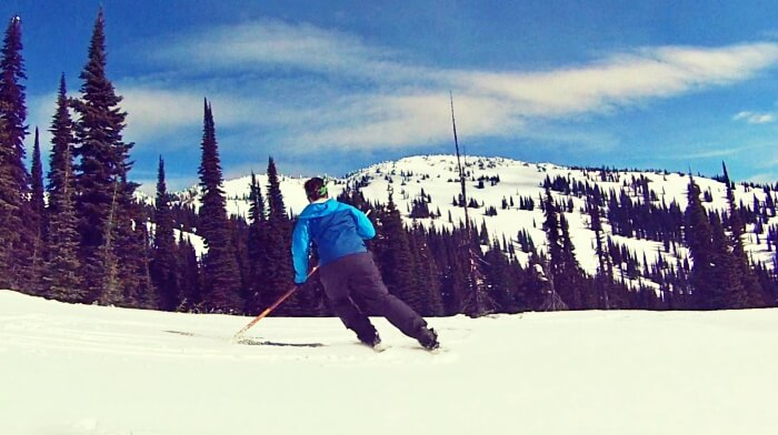 skier skiing on a snowy slope