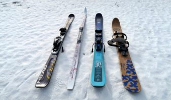 four different skis on snow