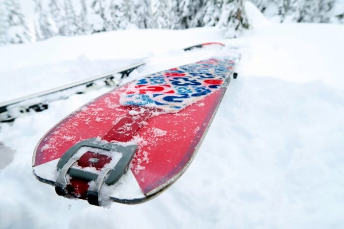 closeup on the backside of a snowy ski