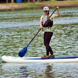 woman on paddle board wearing life jacket