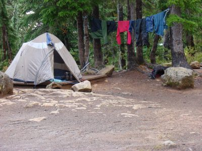 tent in campground with clothes left to dry on a clothes line