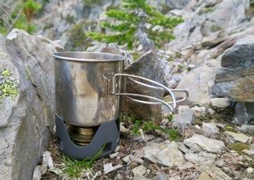 alocs alcohol stove near rocks