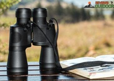 best binoculars for the money on table beside book